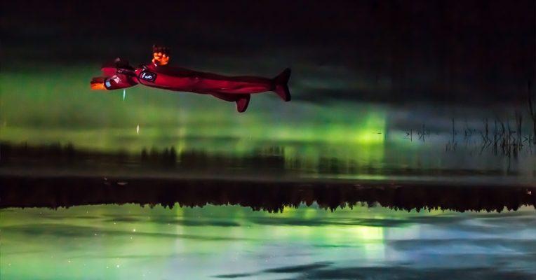 autumn aurora season floating under the northern lights rovaniemi lapland finland
